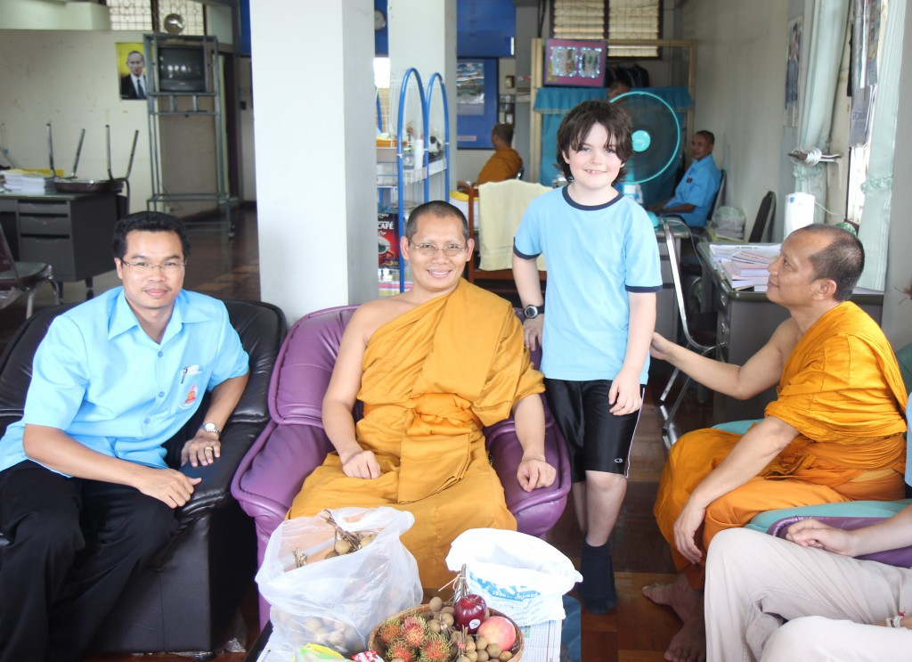 During a break with teachers and administrators at the monastery school in Nong Khai