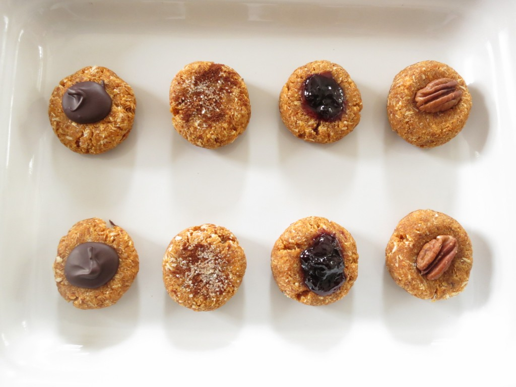 Panellets with chocolate,  cinnamon and sugar, cherry jam, and pecan